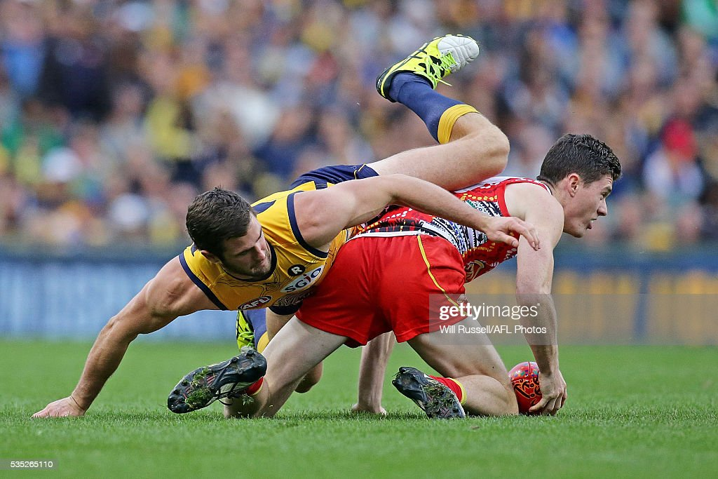 Henry Schade of the Suns is tackled by Jack Darling of the Eagles during the round 10 AFL match between the West Coast Eagles and the Gold Coast Suns at Domain Stadium on May 29, 2016 in Perth, Australia.