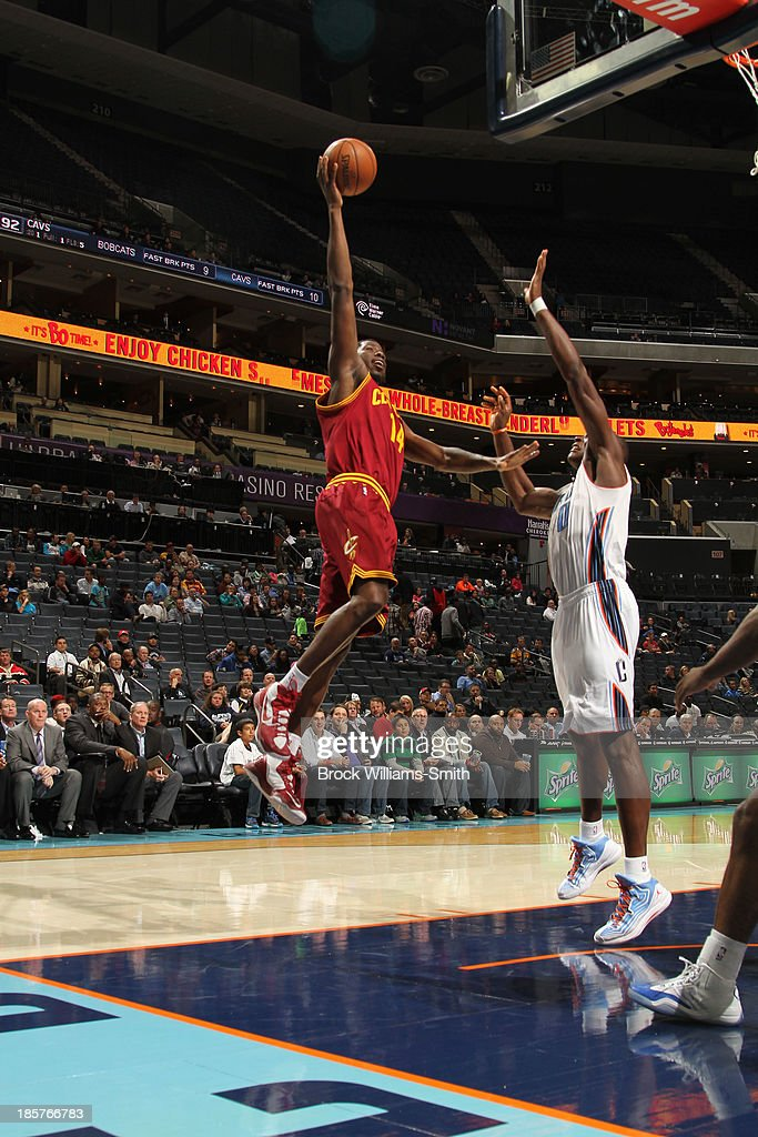 <a gi-track='captionPersonalityLinkClicked' href=/galleries/search?phrase=Henry+Sims&family=editorial&specificpeople=5132323 ng-click='$event.stopPropagation()'>Henry Sims</a> #14 of the Cleveland Cavaliers shoots against <a gi-track='captionPersonalityLinkClicked' href=/galleries/search?phrase=Bismack+Biyombo&family=editorial&specificpeople=7640443 ng-click='$event.stopPropagation()'>Bismack Biyombo</a> #0 of the Charlotte Bobcats during the game at the Time Warner Cable Arena on October 24, 2013 in Charlotte, North Carolina.