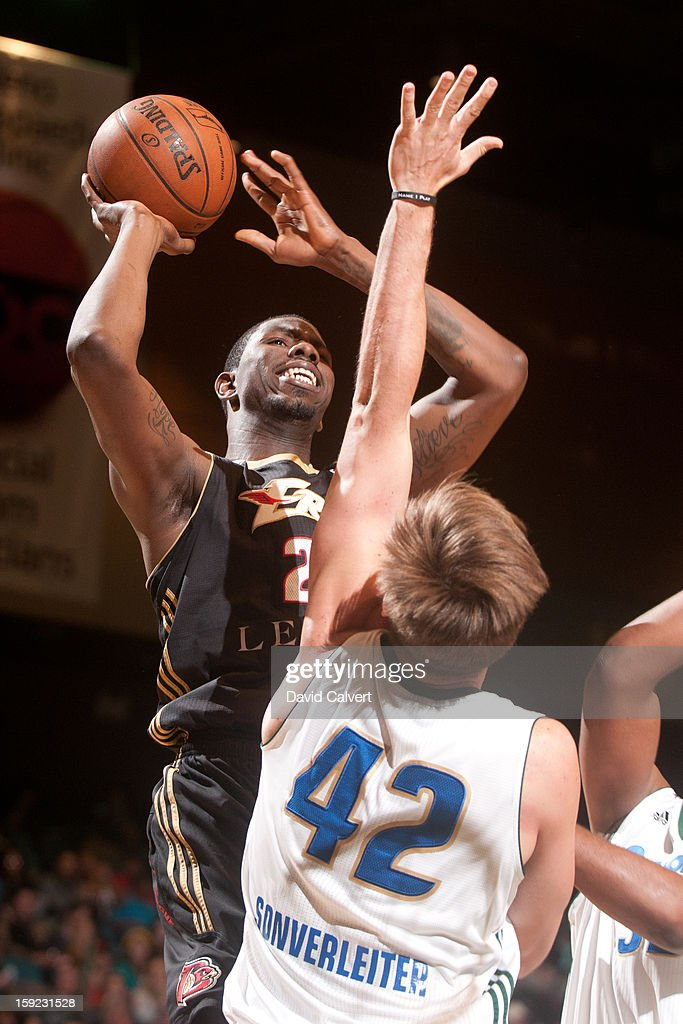 <a gi-track='captionPersonalityLinkClicked' href=/galleries/search?phrase=Henry+Sims&family=editorial&specificpeople=5132323 ng-click='$event.stopPropagation()'>Henry Sims</a> #21 of the Erie BayHawks shoots over defender Sean Sonderleiter #42 of the Reno Bighorns during the 2013 NBA D-League Showcase on January 9, 2013 at the Reno Events Center in Reno, Nevada.