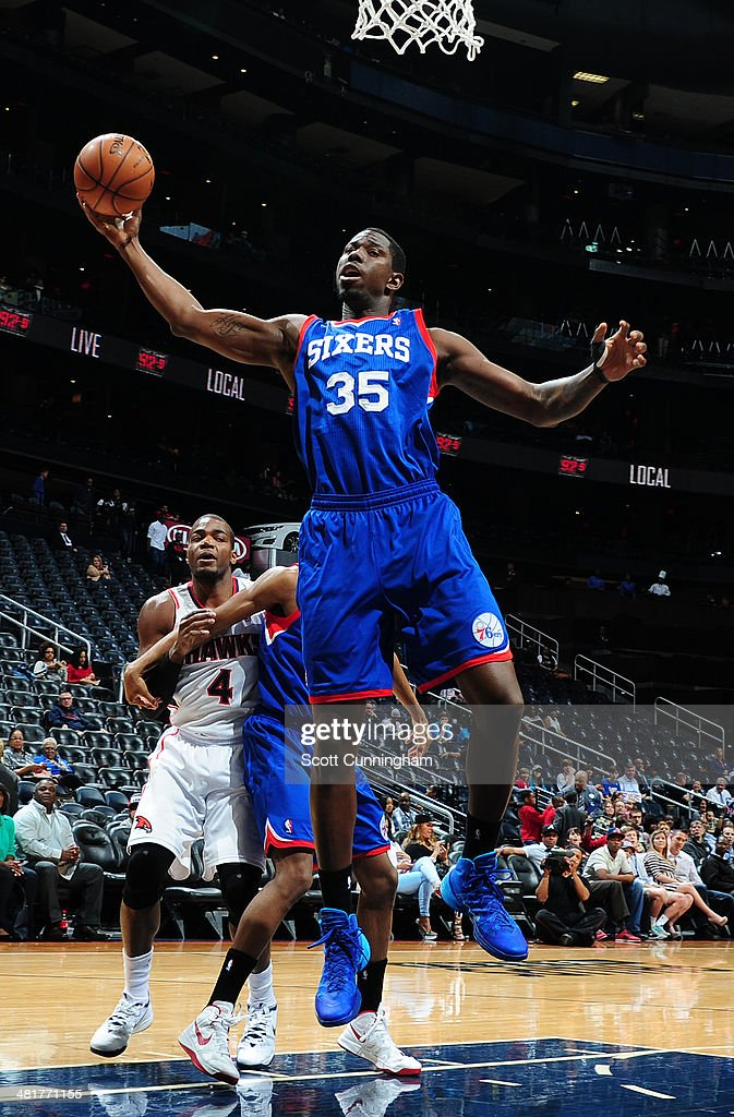 Henry Sims #35 of the Philadelphia 76ers rebounds against the Atlanta Hawks on March 31, 2014 at Philips Arena in Atlanta, Georgia.