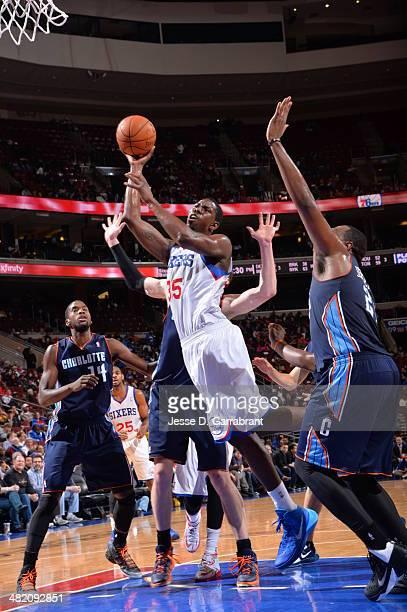 Henry Sims of the Philadelphia 76ers shoots against the Charlotte Bobcats at the Wells Fargo Center on April 2 2014 in Philadelphia Pennsylvania NOTE...