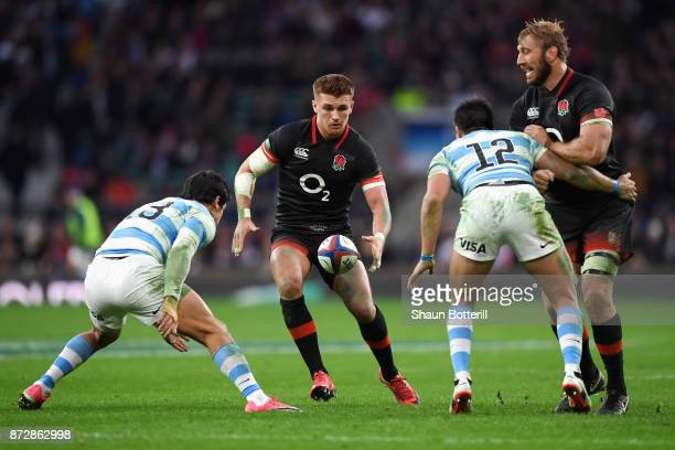 Henry Slade of England attempts to get past Santiago Gonzal Igleslas of Argentina during the Old Mutual Wealth Series match between England and...