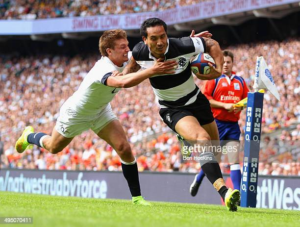 Henry Slade of England fails to stop Hosea Gear of the Barbarians scoring his first try during the Rugby Union International Match between England...