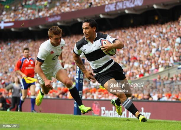 Henry Slade of England fails to stop Hosea Gear of the Barbarians scoring his second try during the Rugby Union International Match between England...