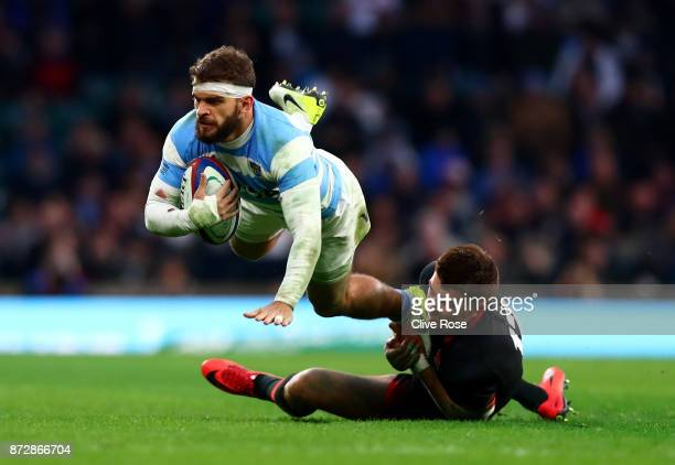 Henry Slade of England tackles Emiliano Boffelli of Argentina during the Old Mutual Wealth Series match between England and Argentina at Twickenham...
