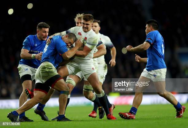 Henry Slade of England tackles Paul Perez of Samoa during the Old Mutual Wealth Series match between England and Samoa at Twickenham Stadium on...