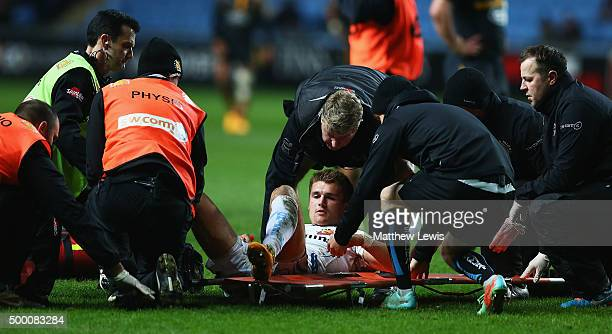 Henry Slade of Exeter Chiefs is stretched off during the Aviva Premiership match between Wasps and Exeter Chiefs at the Ricoh Arena on December 4...