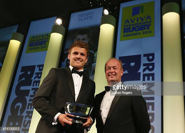 Henry Slade of Exeter Chiefs receives the Land Rover Discovery of the Season award from Jeremy Hicks managing director of Jaguar Land Rover during...