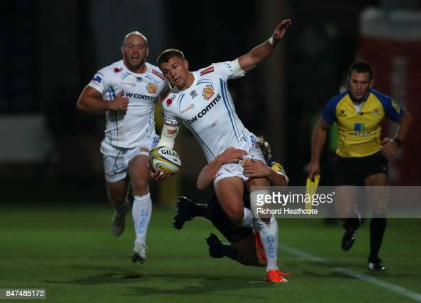 Henry Slade of Exeter is tackled by Jack Singleton of Worcester during the Aviva Premiership match between Worcester Warriors and Exeter Chiefs at...