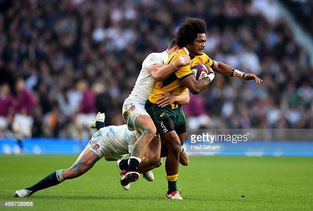 Henry Speight of Australia is hauled down by the England defence during the QBE international match between England and Australia at Twickenham...