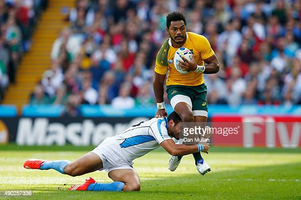 Henry Speight of Australia is tackled by Joaquin Prada of Uruguay during the 2015 Rugby World Cup Pool A match between Australia and Uruguay at Villa...