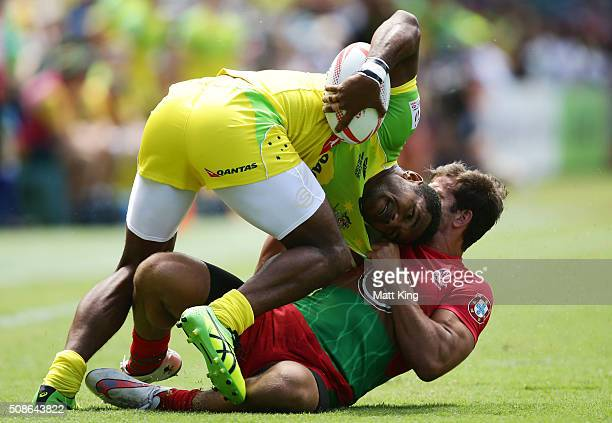 Henry Speight of Australia is tackled by Tiago Fernandes of Portugal during the 20146 Sydney Sevens match between Australia and Portugal at Allianz...