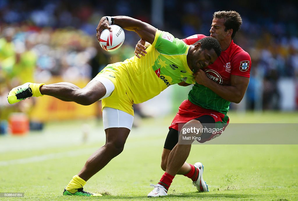 Henry Speight of Australia is tackled by Tiago Fernandes of Portugal during the 20146 Sydney Sevens match between Australia and Portugal at Allianz Stadium on February 6, 2016 in Sydney, Australia.