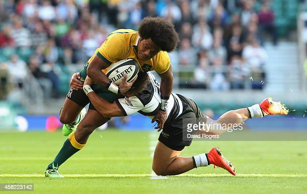 Henry Speight of Australia is tackled by Tim NanaiWilliams during the Killick Cup match between the Barbarians and Australian Wallabies at Twickenham...