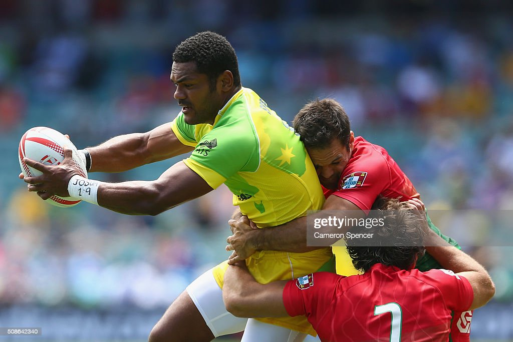 <a gi-track='captionPersonalityLinkClicked' href=/galleries/search?phrase=Henry+Speight&family=editorial&specificpeople=4388674 ng-click='$event.stopPropagation()'>Henry Speight</a> of Australia is tackled during the 2016 Sydney Sevens match between Australia and Portugal at Allianz Stadium on February 6, 2016 in Sydney, Australia.