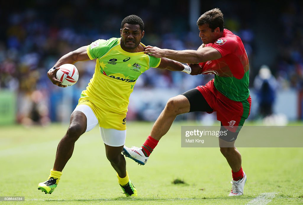 Henry Speight of Australia puts a fend on Tiago Fernandes of Portugal during the 20146 Sydney Sevens match between Australia and Portugal at Allianz Stadium on February 6, 2016 in Sydney, Australia.