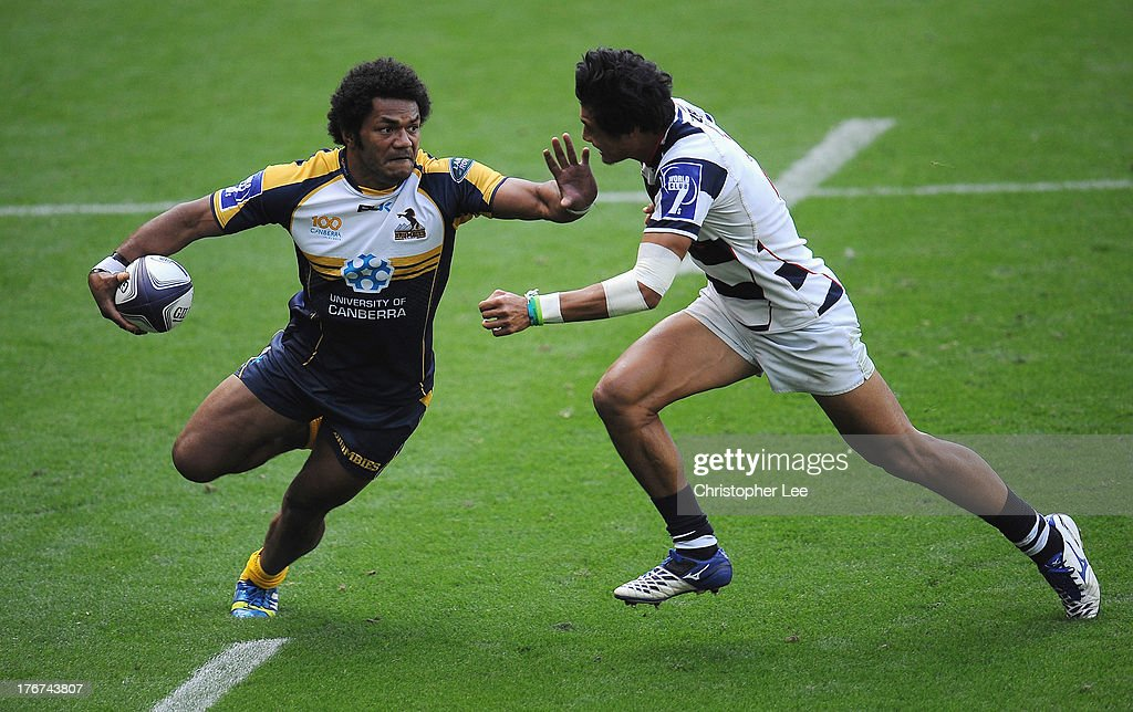 Henry Speight of Brumbies holds off Melani Vai of Auckland during the Cup Final of the World Club 7's 2013 at Twickenham Stadium on August 18, 2013 in London, England.