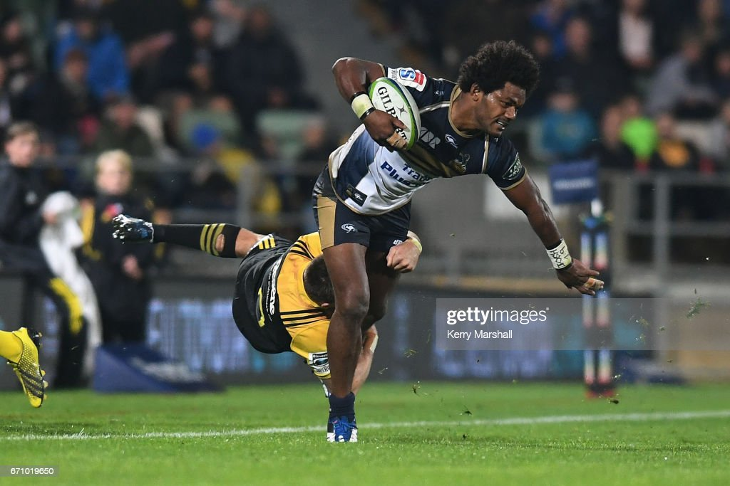 Henry Speight of the Brumbies is dragged into touch by Beauden Barrett of the Hurricanes during the round nine Super Rugby match between the Hurricanes and the Brumbies at McLean Park on April 21, 2017 in Napier, New Zealand.