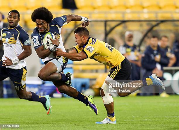 Henry Speight of the Brumbies is tackled by Alapati Leiua of the Hurricanes during the round four Super Rugby match between the Hurricanes and the...