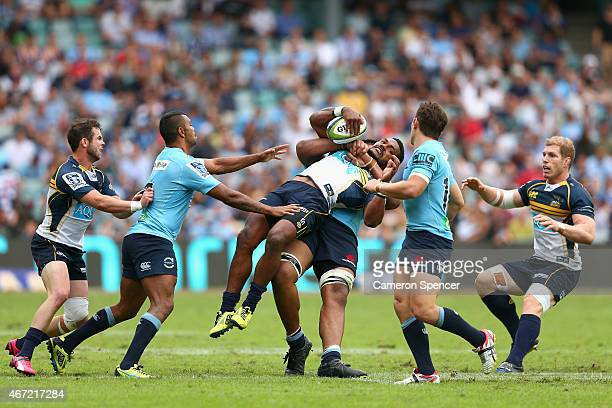 Henry Speight of the Brumbies is tackled by Will Skelton of the Waratahs during the round six Super Rugby match between the Waratahs and the Brumbies...
