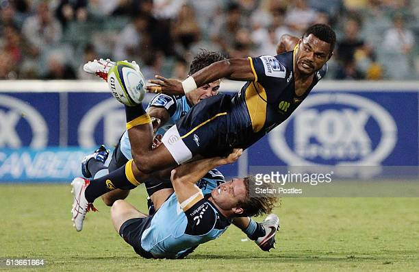Henry Speight of the Brumbies off loads the ball during the round two NRL match between the Brumbies and the Waratahs at GIO Stadium on March 4 2016...