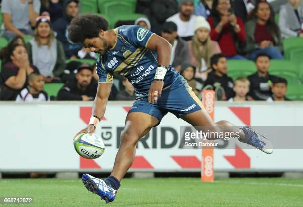Henry Speight of the Brumbies runs in to score a try during the round eight Super Rugby match between the Rebels and the Brumbies at AAMI Park on...