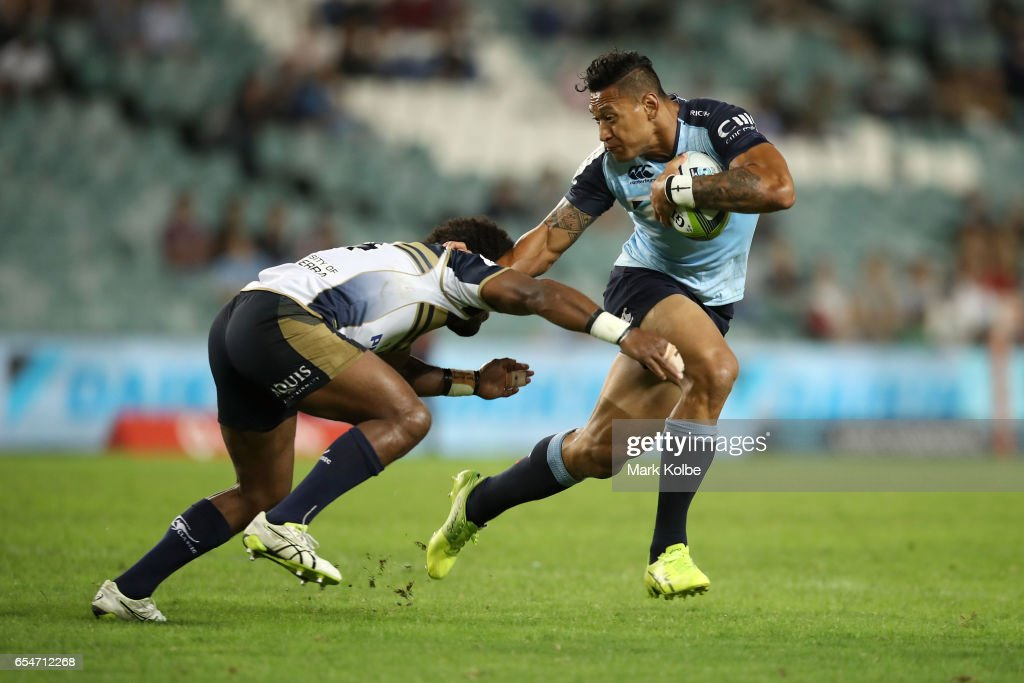 Henry Speight of the Brumbies tackles Israel Folau of the Waratahs during the round four Super Rugby match between the Waratahs and the Brumbies at Allianz Stadium on March 18, 2017 in Sydney, Australia.