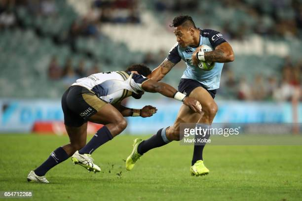 Henry Speight of the Brumbies tackles Israel Folau of the Waratahs during the round four Super Rugby match between the Waratahs and the Brumbies at...