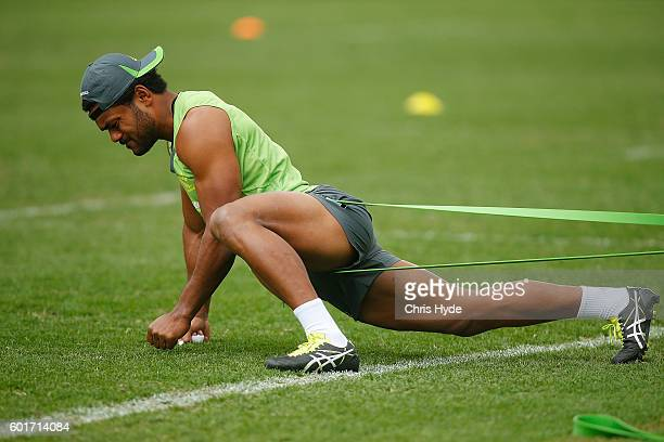 Henry Speight stretches during the Australian Wallabies captain's run at Ballymore Stadium on September 9 2016 in Brisbane Australia