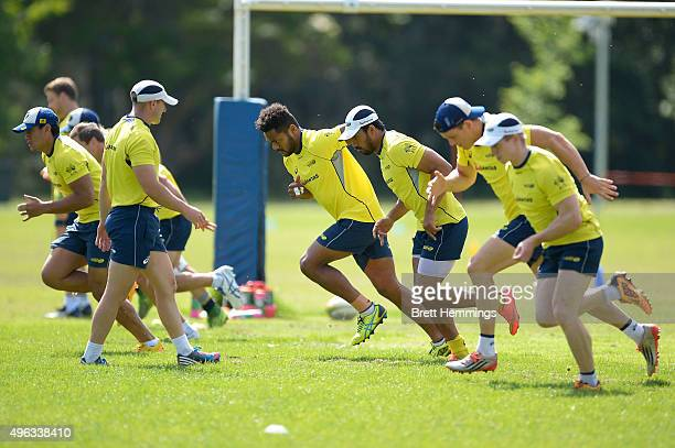 Henry Speight warms up with team mates during an Australian men's rugby sevens training session at Sydney Academy of Sport on November 9 2015 in...