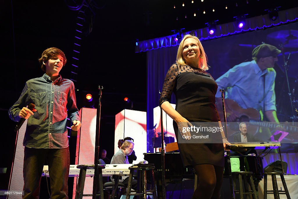 Henry Taylor (L) and Kim Taylor perform onstage at Madison Square Garden on December 5, 2014 in New York City.