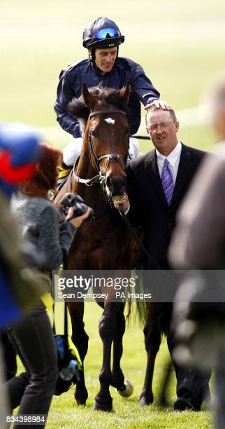 Henry the navigator and jockey Johnny Murtagh with Head Travelling Lad Pat Keating after winning the Stanjamesukcom 2000 Guineas Stakes during the...