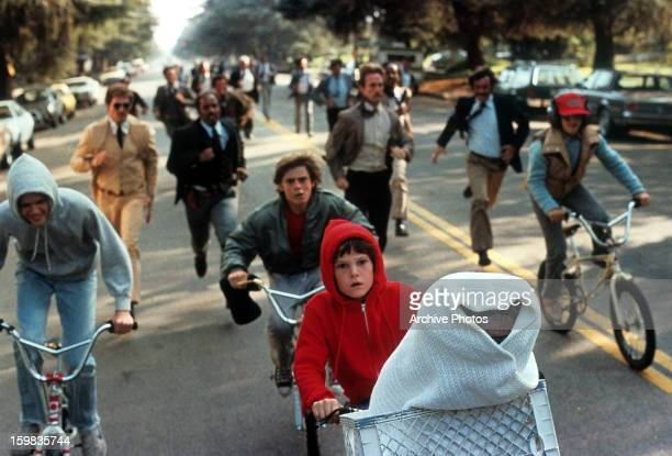 Henry Thomas riding with ET in his bike in a scene from the film 'ET The ExtraTerrestrial' 1982