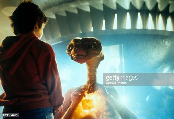 Henry Thomas talking with ET in a scene from the film 'ET The ExtraTerrestrial' 1982