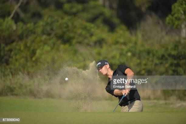 Henry Todd of the United States hits from bunker on the 14th hole during the third round of the PGA TOUR Latinoamerica 64 Aberto do Brasil at the...