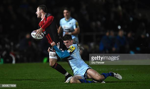 Henry Trinder of Gloucester is tackled by Ben Howard of Worcester during the European Rugby Challenge Cup match between Worcester Warriors and...