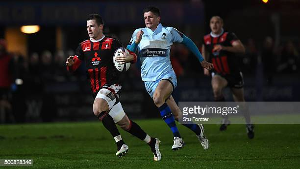 Henry Trinder of Gloucester outpaces Ben Howard of Worcester during the European Rugby Challenge Cup match between Worcester Warriors and Gloucester...