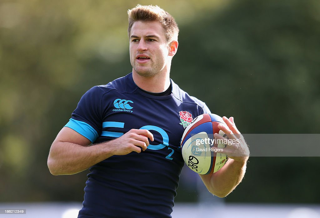 Henry Trinder runs with the ball during the England training session held at Pennyhill Park on October 29, 2013 in Bagshot, England.