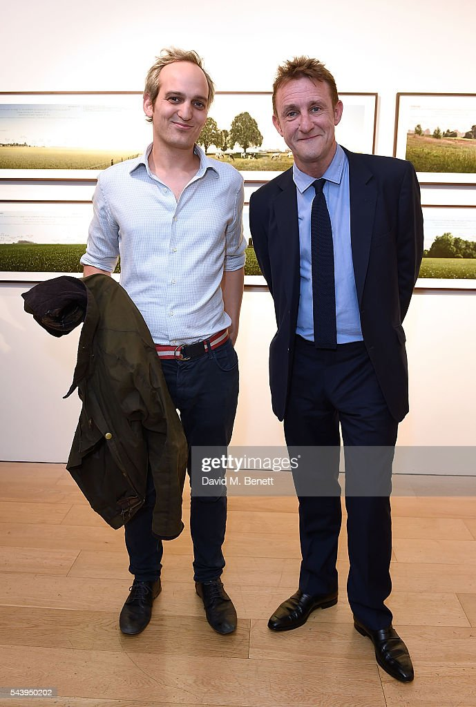 Henry Williams (L) and Jolyon Fenwick attend the exhibition launch party of 'The Zero Hour Panoramas' by Jolyon Fenwick. The exhibition consists of 14 photographic panoramas showcasing, '100 Years on: Views From The Parapet of the Somme', at Sladmore Contemporary on June 30, 2016 in London, England.