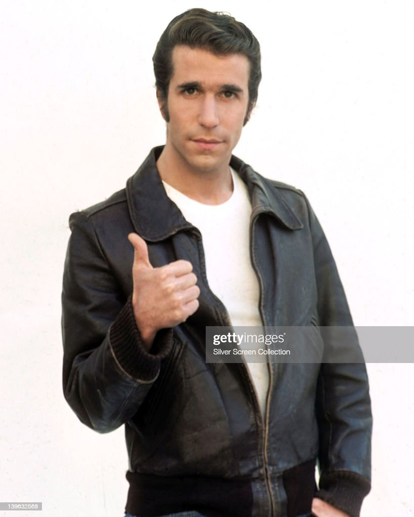 <a gi-track='captionPersonalityLinkClicked' href=/galleries/search?phrase=Henry+Winkler+-+Actor&family=editorial&specificpeople=206799 ng-click='$event.stopPropagation()'>Henry Winkler</a>, US actor, wearing a black leather jacket and white t-shirt, giving a thumbs up in a publicity portrait, against a white background, issued for the US television series, 'Happy Days', USA, circa 1977. The sitcom starred Winkler as 'Arthur Fonzarelli', popularly known as 'The Fonz.