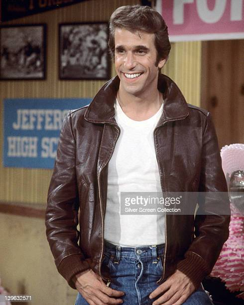 Henry Winkler US actor wearing a brown leather jacket and white tshirt in a publicity still issued for the US television series 'Happy Days' USA...