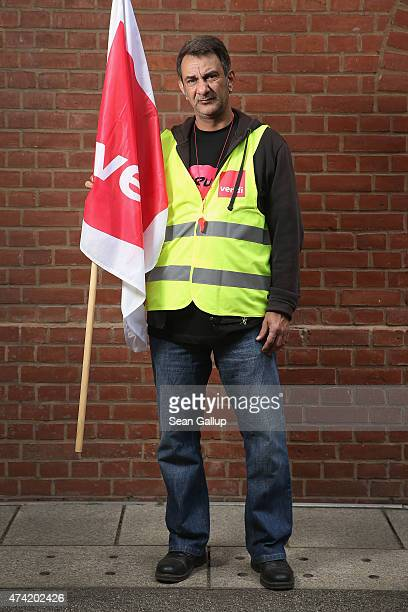 Henry Yusuf an employee of Deutsche Post and who has joined a strike organized by the verdi labor union poses for a photo on May 19 2015 in Berlin...