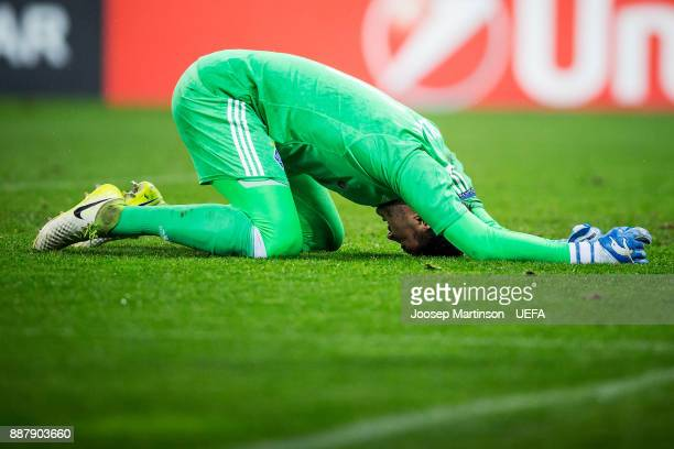 Heorhiy Bushchan of FC Dynamo Kyiv reacts after a collision during the UEFA Europa League group B match between FC Dynamo Kyiv and FK Partizan...