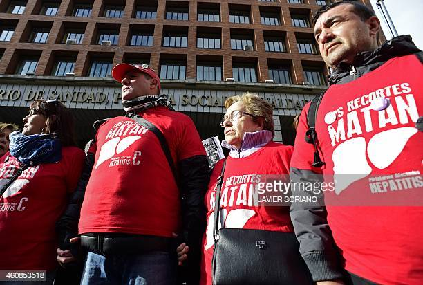 Hepatitis C sufferers and supporters demonstrate outside Spain's health ministry on December 27 2014 complaining are being denied access to a new...