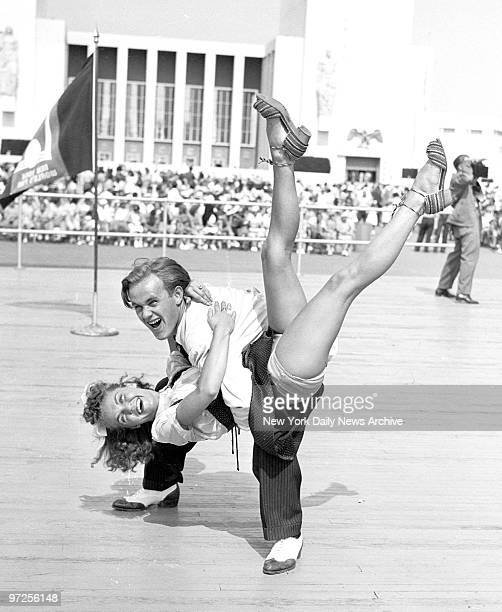 Hepcats James Brennan and Tessie Fekan swing out at World's Fair jitterbug contest and win it