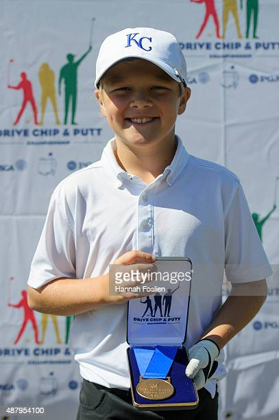 Hepler poses for a photo after winning first place overall at a Regional Finals for 1011 year old boys at the Drive Chip and Putt competition on...