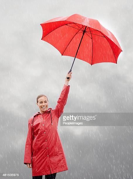 Her attitude shines through the rain