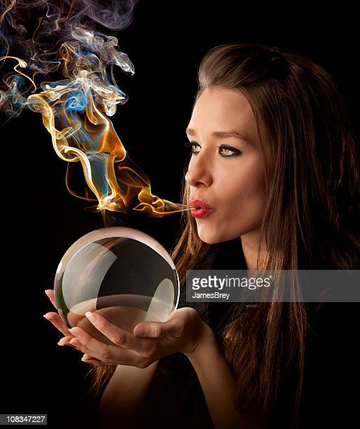 Her Elemental Magic-Fortune Teller Blows Magic-Smoke Over Crystal Ball