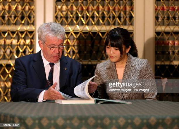 Her Imperial Highness Princess Mako of Akishino the first daughter of His Imperial Highness Prince Akishino in Japan is shown the bookThe Building of...