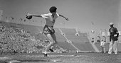 Her leg muscles standing out like steel cables Stella Walsh representing Poland tightens up to heave the discus during the event in the Los Angeles...